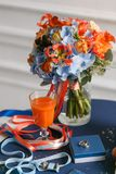Bright and juicy color Wedding bouquet different flowers. Modern bridal bunch with orange tulips, red gloriosa, blue. Hydrangea, Calla Royalty Free Stock Photography