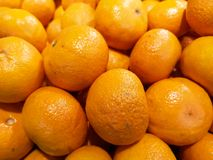 Bright and juicy oranges, displayed at a local market, ready to be placed into the daily buyers` basket. royalty free stock photos