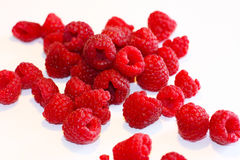 Bright juicy raspberries. Bright, juicy, red raspberry closeup on a white background Stock Photos