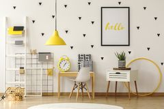 Bright kid play room interior with wooden furniture and black tr stock image