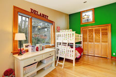 Bright kids room with loft bed Stock Images