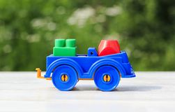 Kids toy train made of plastic outdoors in the summer. Bright kids toy train made of plastic outdoors in the summer royalty free stock photo