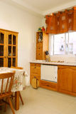 Bright kitchen. Bright wooden kitchen with window Royalty Free Stock Images