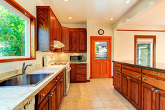 Bright kitchen with carved wood cabinets Royalty Free Stock Image