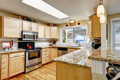 Bright kitchen with granite tops and skylight Stock Photo
