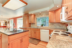 Bright kitchen interior with oak wood cabinetry Stock Images