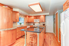 Bright kitchen interior with oak wood cabinetry Stock Photos