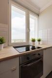 Bright kitchen overlooking neighborhood Royalty Free Stock Photos