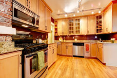 Bright kitchen room with brick designed wall Royalty Free Stock Photography