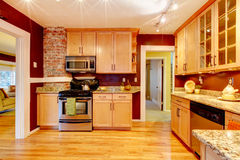 Bright kitchen room with brick designed wall Royalty Free Stock Image