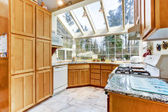 Bright kitchen room with glass wall and ceiling Stock Photography