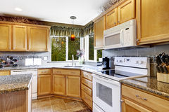 Bright kitchen room interior with white appliances Stock Image