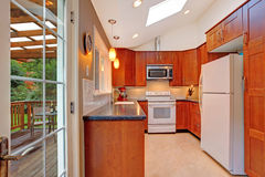 Bright kitchen room with skylight and walkout deck Stock Photography