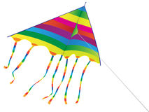 Bright kite. Toy a bright kite on a background of the blue sky - Isolated Royalty Free Stock Photos