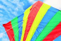 Bright Kite 1. Bright kite flying close up against the blue sky Royalty Free Stock Photo
