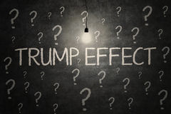 Bright lamp and Trump Effect word. JAKARTA, November 17, 2016: Image of a bright light bulb with question marks and text of Trump Effect on the chalkboard Stock Photos