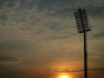Bright large tall outdoor stadium spotlights Royalty Free Stock Photo