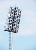 Bright large tall outdoor stadium spotlights Stock Photos