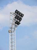 Bright large tall outdoor stadium spotlights Stock Photo