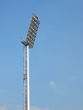 Bright large tall outdoor stadium spotlights Stock Images