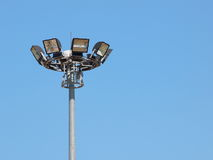 Bright large tall outdoor stadium spotlights Royalty Free Stock Images