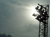 Bright large tall outdoor stadium spotlights Royalty Free Stock Image