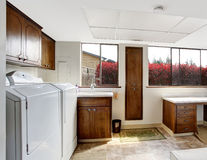 Bright laundry room with dark brown cabinets Royalty Free Stock Photos