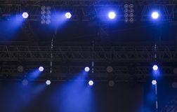 Bright LED spot lights. Bright lightning LED spot lights at the truss of an open-air stage stock images