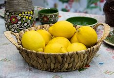 Bright lemons in a basket stock images