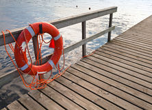 Bright Lifebuoy on the pier Royalty Free Stock Photos
