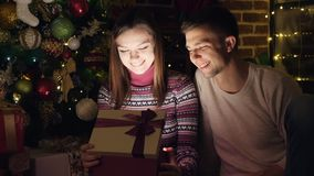 Bright light from the box. Christmas gift stock footage