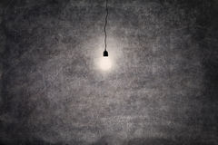 Bright light bulb on blackboard Royalty Free Stock Photo
