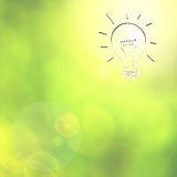Bright light bulb sketch on abstract blurred background Stock Photo