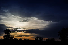 Bright light and dark clouds Royalty Free Stock Image