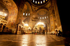 Bright light in the dark hall in the Cathedral. SOFIA, BULGARIA: Bright light in the dark hall with some people in the The St. Alexander Nevsky Cathedral. The Royalty Free Stock Photos