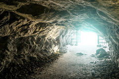 Bright light at the end of the caves in the Mountain Park of Rus Stock Images
