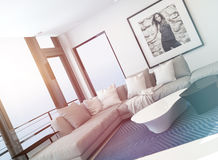 Bright light sitting room interior bathed in sun. Light through a lager view window overlooking the ocean with a comfortable modern corner lounge suit and art on Stock Photography