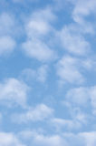 Bright light sky cloudscape background, sunny summer day clouds, vertical copy space Royalty Free Stock Photography