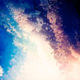 Bright light splash blue sky clouds abstract background Stock Photo