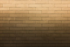 Bright light on texture brick wall pattern. Bright light flood on top of brown texture brick wall pattern Royalty Free Stock Photos