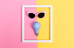 Bright light theme with lightbulb and sunglasses Stock Images