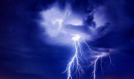 Bright lightning from the clouds. Bright  of big electric lightning storm thunderstorms sparkle from the cloud dangerous rain inside terrible Stock Photography