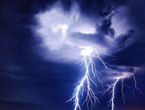 Bright lightning  from the clouds. Bright lightning storm thunderstorms sparkle from the cloud dangerous rain inside terrible Stock Images