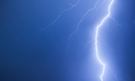 Bright lightning on a dark blue night sky Royalty Free Stock Photos