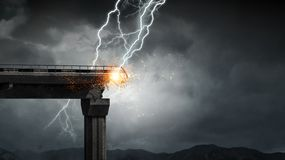 Bright lightning from sky. Heavy clouds and lightning striking and crashing bridge. Mixed media Stock Photography