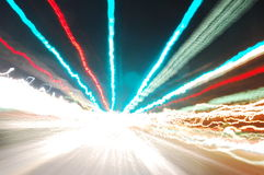 Bright lights. This picture was taken by strapping my camera to the handlebars of my motorcycle and driving around town at night. The pictures I take like this Royalty Free Stock Photo