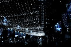 Bright lights on Ben Gurion street of Haifa city in Israel, view of the Bahai temple. hanging garlands and festive decorations stock photography