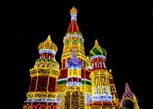 Bright lights decoration in form of Saint Basil`s Cathedral Sob. Or Vasiliya Blazhennogo, Cathedral of Vasily the Blessed in evening Moscow, Russia royalty free stock images