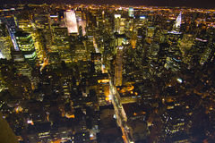 Bright lights new york city by night Stock Photography