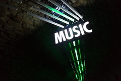 Bright lights in night club with music sign